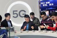 Stand promosi berteknologi 5G di China International Import Expo baru-baru ini di Shanghai. (Foto: Jin Rong / China Daily)