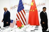 Presiden China Xi Jinping dan Presiden AS Donald Trump menghadiri pertemuan bilateral di sela KTT G20 di Osaka pada 29 Juni 2019. (Foto: AFP)