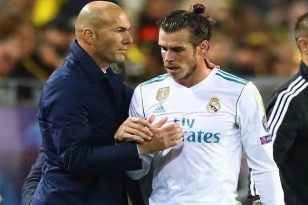 Zinedine Zidane bersama Gareth Bale