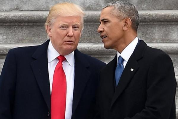 Mantan dan Presiden Amerika Serikat saat ini , Barack Obama dan Donald Trump (AFP/Robyn Beck)