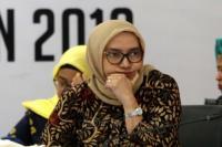 Jokowi Berhentikan Evi Novrida Secara Tidak Hormat