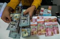 Nilai tukar rupiah ditutup stagnan pada perdagangan antarbank hari ini, Kamis (4/6/2020).